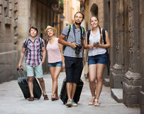 Travelers with travel bags walking Stock Image