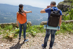 Travelers travel on the road in mountains go trekking together. Active hikers. Trekking together. Eco tourism and healthy lifestyle concept. Two young Tourists stock photo