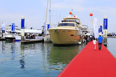 Travelers visiting on the red pontoon. China ( xiamen city ) international boat show 2014 was held in music island of wuyuanwan marina on 7th to 10th, november Royalty Free Stock Photography