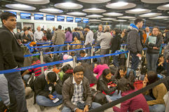 Travelers waiting in airport at snowstorm stock images