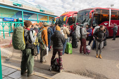 Travelers waiting for boarding autobus in Puno, Peru. Puno, Peru - August 18, 2015: Group of people, mostly foreign tourists and travelers, waiting for boarding Stock Photo