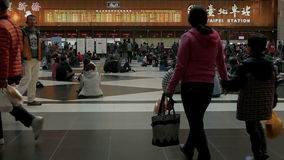 Travelers waiting and walking in ticket lobby at Taipei Train Station, slow motion. TAIPEI,  TAIWAN - FEBRUARY 9, 2016: Travelers waiting and walking in ticket stock video