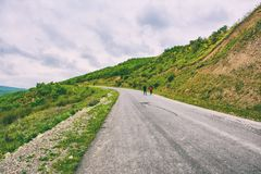 Travelers walk on road Royalty Free Stock Photography