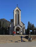 Travelers walking on the sidewalk of the square in front of the Catholic Holy Rosary church in Sapa Stock Photo