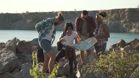 Travelers watching map while traveling stock footage