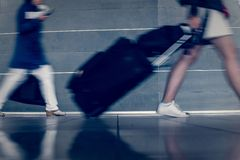 Travelers With Baggage Walking Royalty Free Stock Images