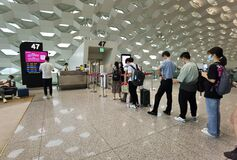 Free Travelers With Masks Boarding In Line, Shenzhen, China Stock Photo - 225052190