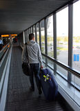 Traveling. A traveling men on an airport in the Netherlands Royalty Free Stock Image
