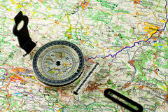 Traveling. Compass on the map background Stock Photos