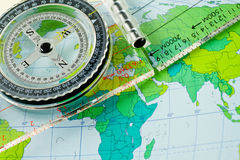 Traveling. Compass on the map background Royalty Free Stock Photos