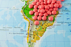 Traveling. Drugs on a background map Royalty Free Stock Image