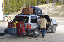 Traveling. Overloaded car at stop at gas station at Alaska Highway (Alcan stock images