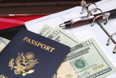 For traveling. Passport ,money in a briefcase Royalty Free Stock Photo