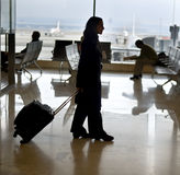 Traveling. Woman traveler in the airport Royalty Free Stock Photos