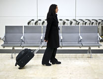 Traveling. Woman traveler in the airport Royalty Free Stock Photography