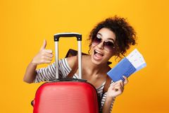 Traveling Abroad, Tourist Showing Thumb Up Over Orange Background. Traveling Abroad, Tourist Showing Thumb Up And Holding Tickets, Orange Background royalty free stock image