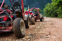 Traveling activity, Off road buggy on country road in rainy day Royalty Free Stock Photography