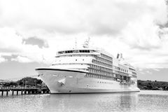 Big cruise ship, white luxury yacht in sea port, Antigua Stock Image