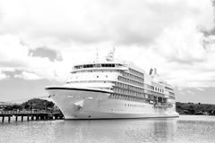 Big cruise ship, white luxury yacht in sea port, Antigua Stock Images