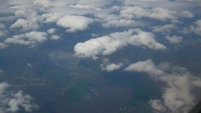 View airplane window. Traveling by air above clouds. View through an airplane window stock footage