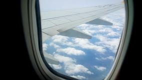 View airplane window. Traveling by air above clouds. View through an airplane window stock video footage
