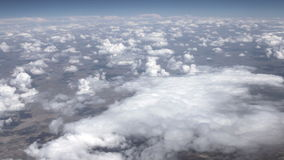 Traveling by air above clouds. View through an airplane window stock video