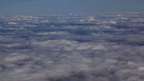 Traveling by air above clouds. View through an airplane window. Flying over the Mediterranean stock video