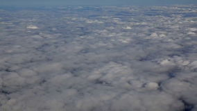 Traveling by air above clouds. View through an airplane window. Flying over the Mediterranean. Sea through cirrus and cumulus clouds and little turbulence stock video