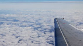 Traveling by air above clouds. View through an airplane window. Flying over the Mediterranean stock video footage