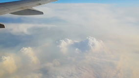 Traveling by air above clouds. View through an airplane window. Flying over the Mediterranean stock footage