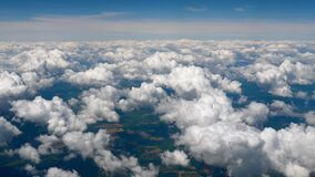 Flying over the clouds. Clouds and skyline horizon panoramic view. Aerial view of skyscape from plane. Fly over clouds
