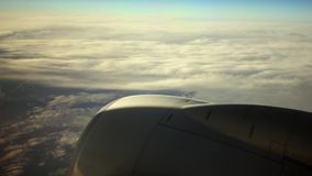 Traveling by Air. HD 1080: Through The Clouds. Traveling by air. View through an airplane window stock video footage