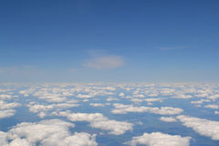 Traveling by air. View through an airplane window. Cirrus and cumulus clouds and little turbulence, showing Earth`s Stock Photos