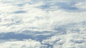 Traveling by air. View through an airplane window. Flight sky clouds stock footage