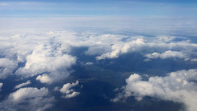 Traveling by air. View through an airplane window. Flying over the Mediterranean Sea through cirrus and cumulus clouds and little turbulence, showing Earth's stock video