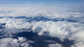 Traveling by air. View through an airplane window. Flying over the Mediterranean Sea through cirrus and cumulus clouds and little turbulence, showing Earth's stock video footage