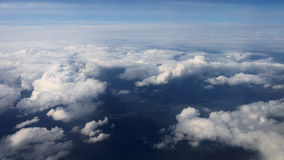 Traveling by air. View through an airplane window. Flying over the sea Stock Images