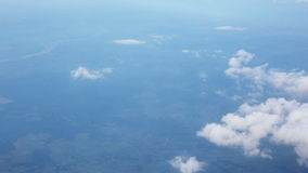 Traveling by air. View through an airplane window. Flying in the sky above the clouds. Traveling by air. View through an airplane window stock footage