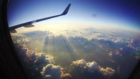 Traveling by Air. View through Airplane Window on Sun Background stock video footage