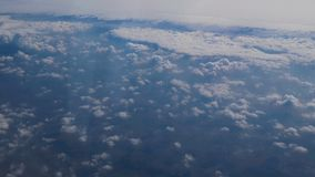 Traveling by air. View through an airplane window. Aerial Shot stock footage