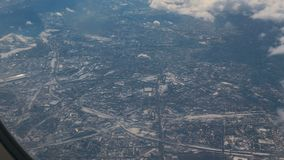 Traveling by air. View through an airplane window. Winter City. Aerial Shot stock video footage
