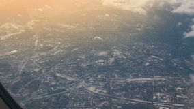Traveling by air. View through an airplane window. Winter City. Aerial Shot stock video
