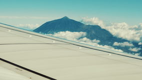 Traveling by air. View of volcano through an airplane window. stock video