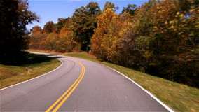 Traveling Along Autumn Road FAST stock video footage