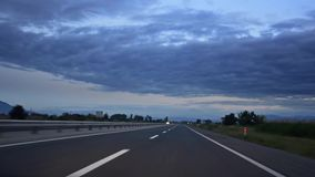 Traveling Along Road highway at sunrise. stock footage