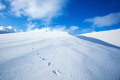 Traveling along snowy mountains Stock Image