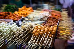 Outdoor streetfood market. Grilled BBQ meat skewers in Asia royalty free stock photography
