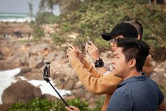 Traveling Asian Tourists Taking Pictures stock images