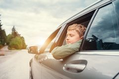 Traveling by auto - son and father look out from car windows Stock Images