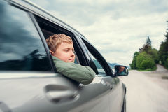 Traveling by auto - son and father look out from car windows Stock Image